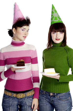 Women with party hat holding cake photo
