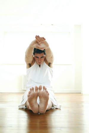 Man practicing yoga photo