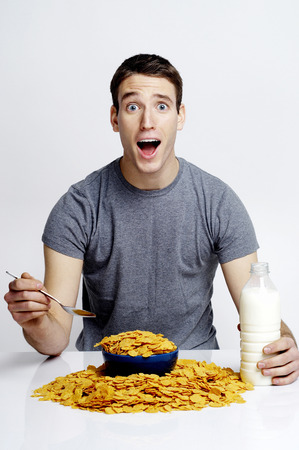 Man in shock with overflowed cereal on the table photo
