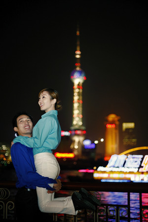 Businessman carrying his girlfriend photo