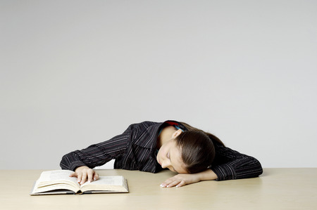 Businesswoman sleeping with her head on the table photo