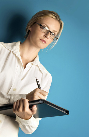 Woman with glasses writing photo