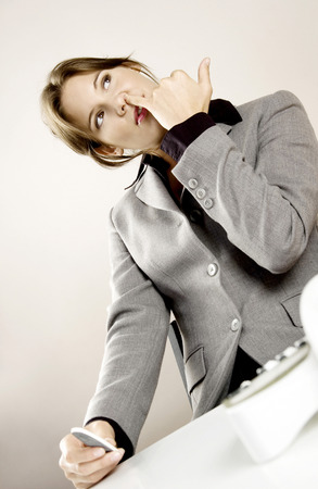 Businesswoman picking her nose photo