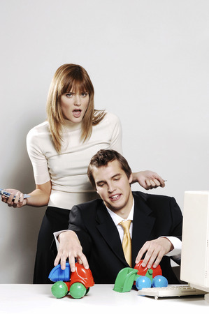 playful behaviour: Businesswoman getting irritated with her colleagues playful behaviour