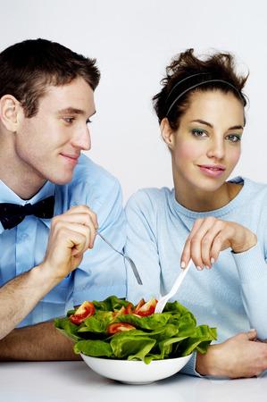 Couple sharing a bowl of salad photo