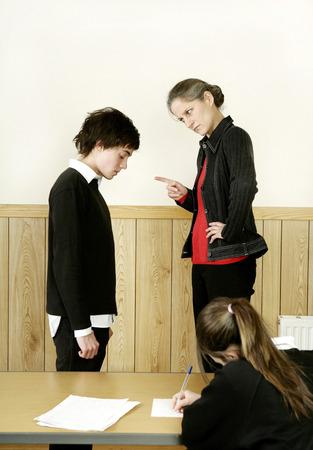 Teacher scolding her student Stock Photo