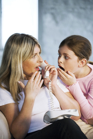 Mother and daughter receiving shocking news photo
