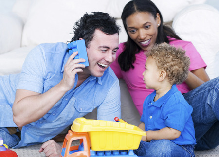 he and she: Young parents playing with their son