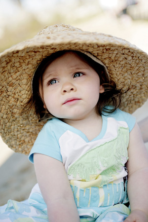 Girl with straw hat photo