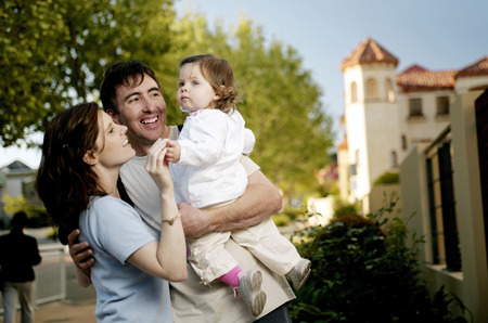 Couple playing with their lovely daughter photo