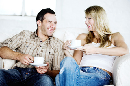 Happy couple resting on couch