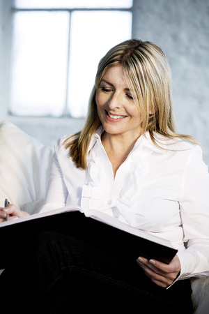 A business lady showing satisfaction while writing