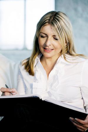 A business lady writing