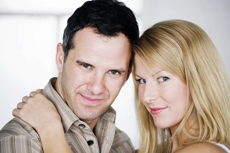 adulthood: Couple smiling and looking at camera