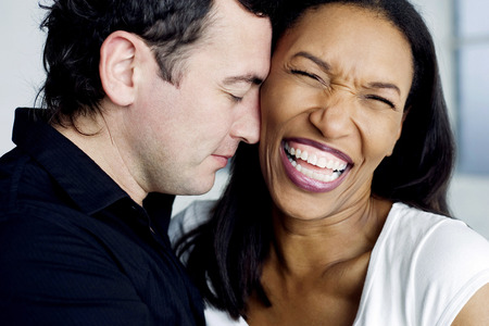 happy moment: Couple of mix ethnicity having happy moment together Stock Photo