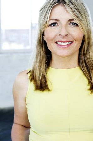 A portrait of a lady wearing yellow singlet