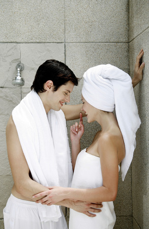 Couple sharing intimate moment in the bathroom photo