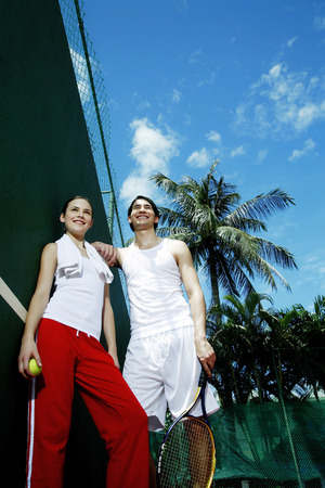 Couple in the tennis court photo