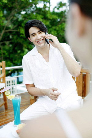 Man laughing while talking on the mobile phone photo