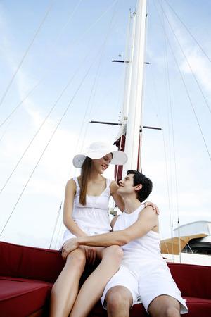 Couple cruising on a yacht photo