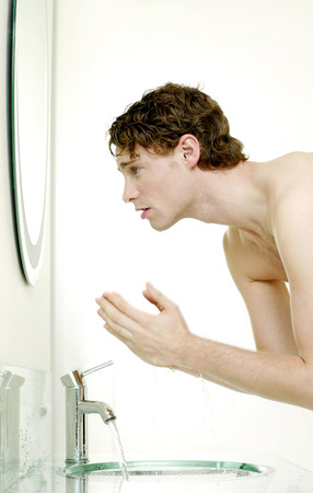 washing up: Man washing face in the bathroom