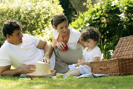 picnicking: Family picnicking in the park