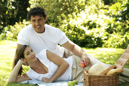 Couple picnicking in the park photo