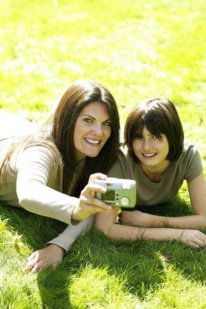 Mother and daughter taking picture in the park Stock Photo