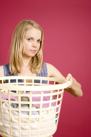 tidiness: Woman holding a basket full of laundry