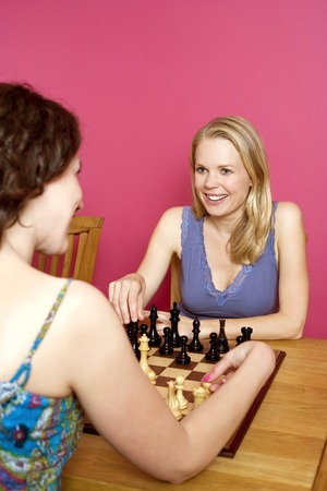 Two women playing chess photo