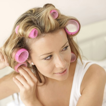 hair curlers: Woman wearing hair curlers Stock Photo