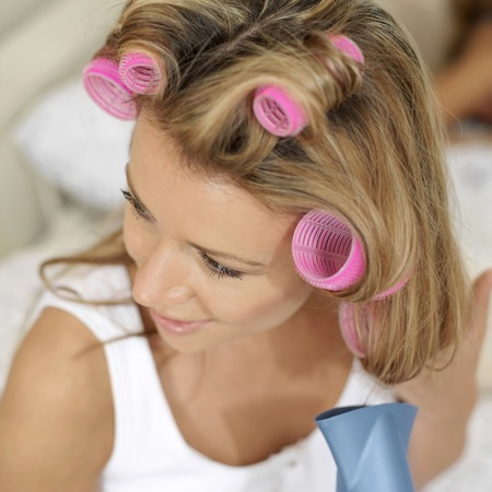 hair curlers: Woman with hair curlers, blowing her hair