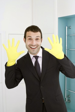 tidiness: Businessman with rubber gloves