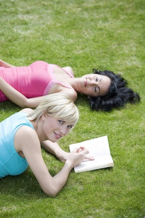 lying forward: Two women in the park reading books