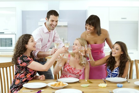 Man and women celebrating together photo
