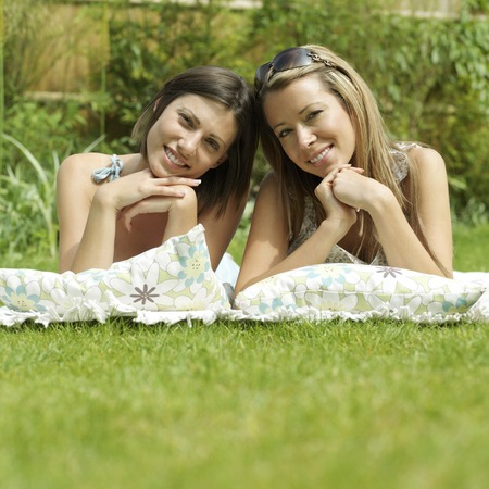 lying forward: Women lying forward in the park Stock Photo