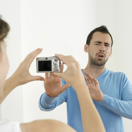 taking a wife: Woman taking mans picture Stock Photo