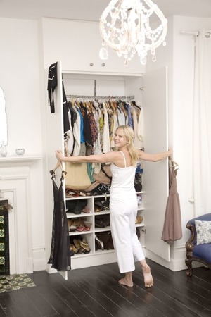 Woman opening her wardrobe photo