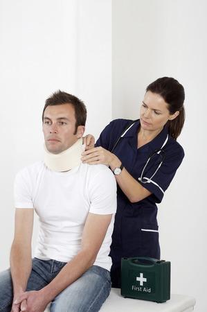 Female nurse treating a patient photo