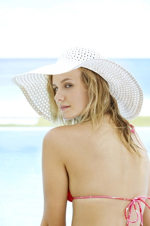 Woman in bikini wearing a straw hat photo