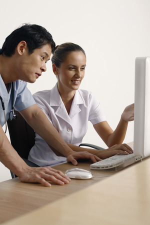 central european ethnicity: Doctor and nurse using computer