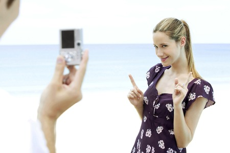 Man taking womans photograph photo