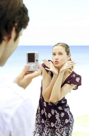 he she: Man taking womans photograph