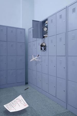 Overflowing locker with things dropping out from it photo