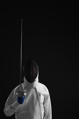fencing foil: Man holding a fencing foil