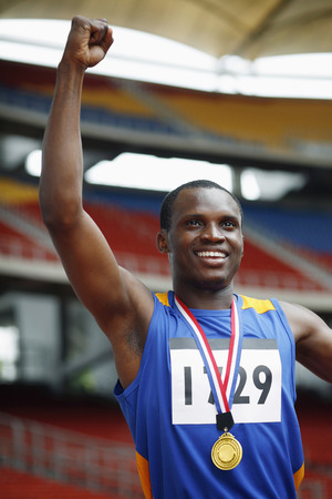 jubilating: Man with gold medal celebrating his success