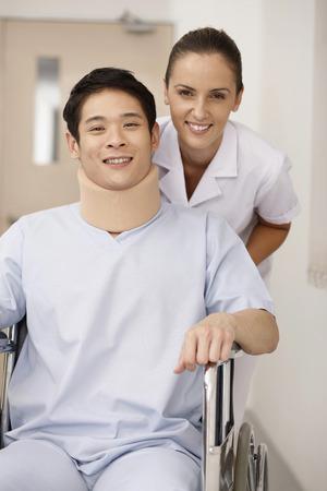 Nurse pushing patient on wheelchair photo