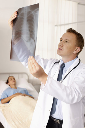Doctor looking at X-ray image photo