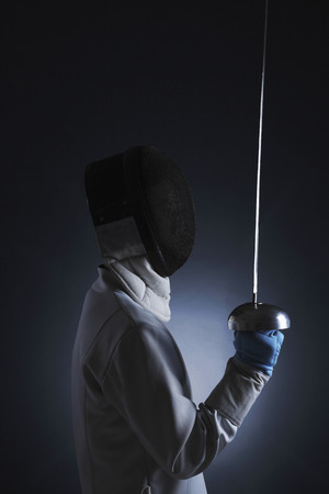 Man holding a fencing foil photo