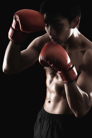 Man with red boxing gloves photo